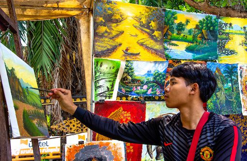 man concentating on painting