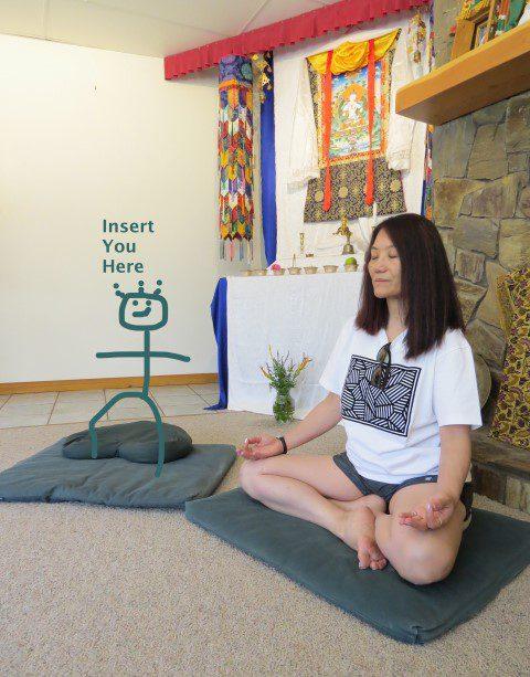 stick cartoon meditator drawn on a cushion - insert you here